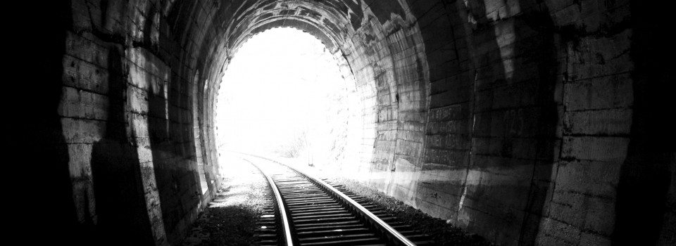 Light on the end of railway tunnel.